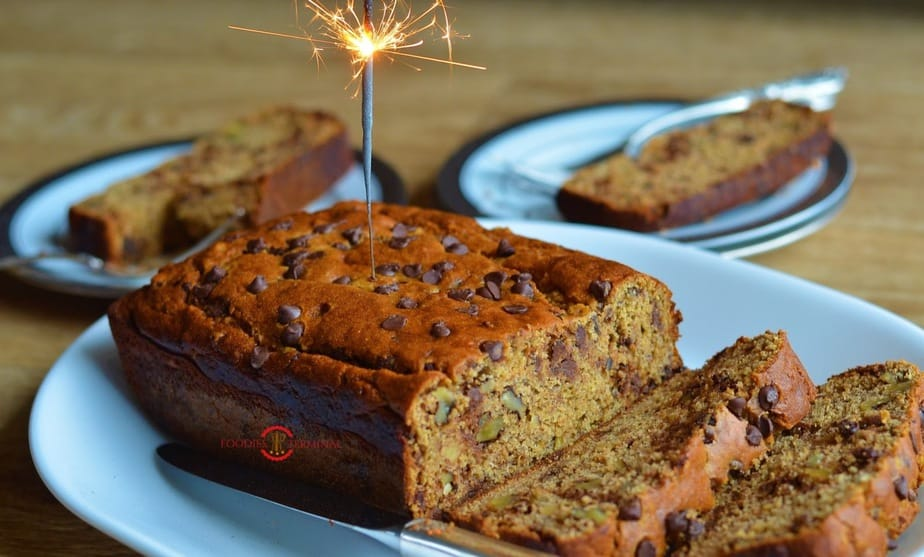 Baked banana bread over a board with a fire stick
