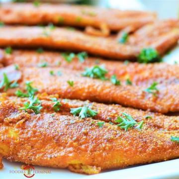 Cajun Fish Fry placed over a tray