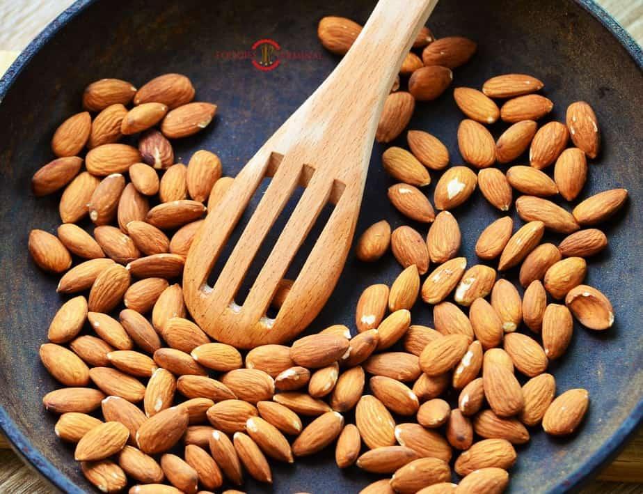 Almonds roasting on a pan