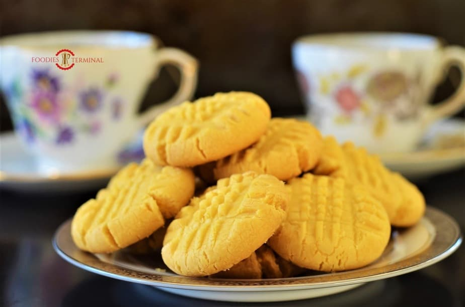 Custard cookies server on a plate with tea.