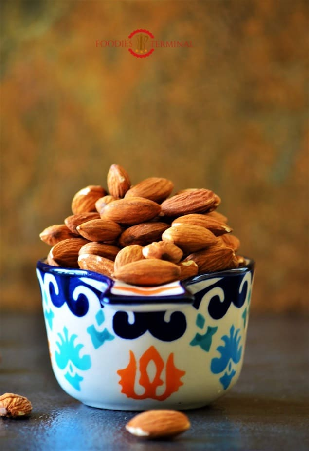 Almonds in a measuring cup.
