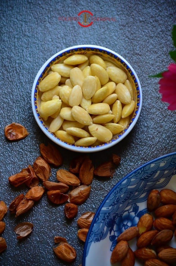 Soaked and pealed almonds in a dish.