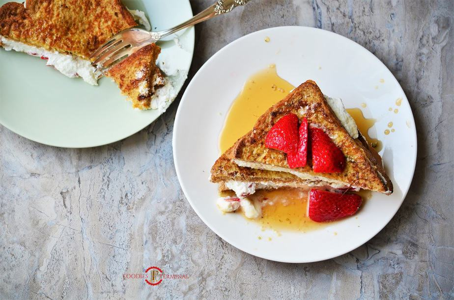 French Toast with Cream Cheese & Strawberry Filling with sauce on plate