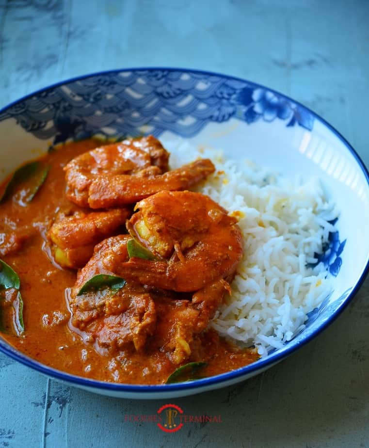Goan Prawn Curry served with rice on a plate.
