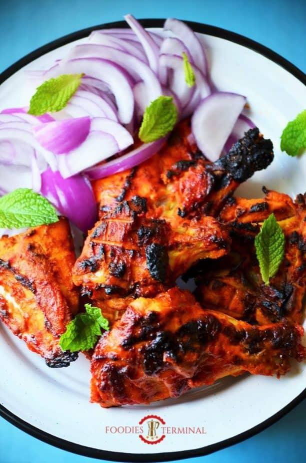 Tandoori chicken served on a dish.