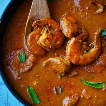Goan Prawn curry decorated with curry leaves