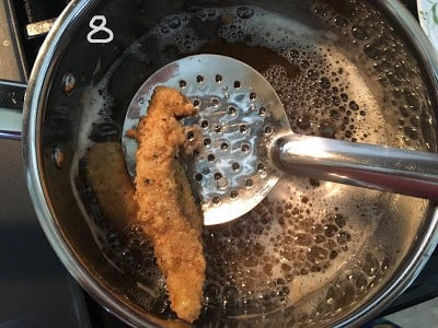 Deep fry the fish finger.