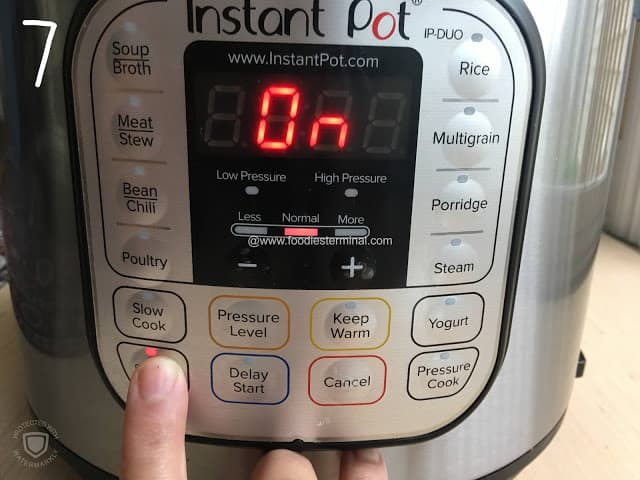 Instant pot being set to saute mode to prepare the ghugni masala