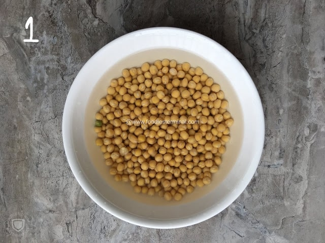 Yellow peas soaked in a white container.