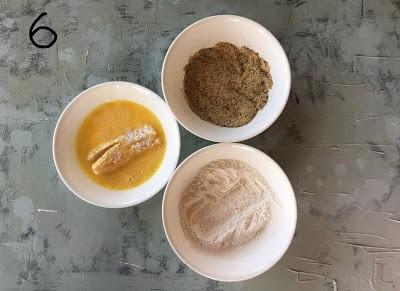 Egg wash the flour coated fish finger.
