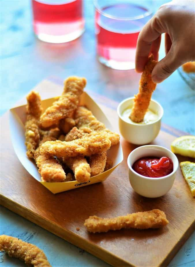 Crispy home-made fish finger dipped in sauce.