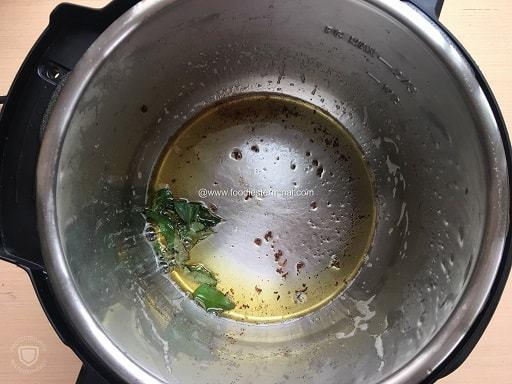 Curry leaves sizzling in oil in Instant Pot