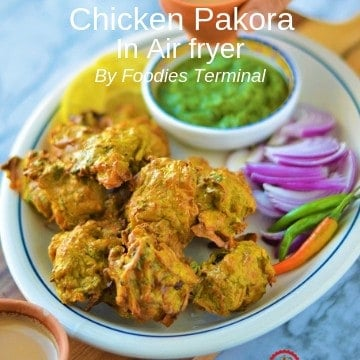 Chicken Pakora air fryer served in an oval plate