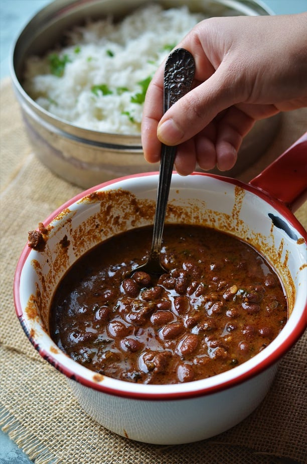Instant Pot Rajma Chawal recipe is served in a white saucepan with red rim