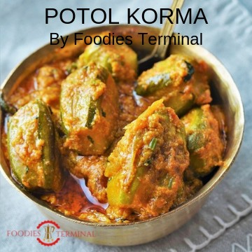 Potol Korma served in a small brass bowl