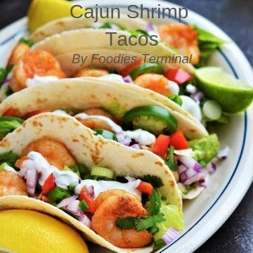 Four Cajun Shrimp tacos served