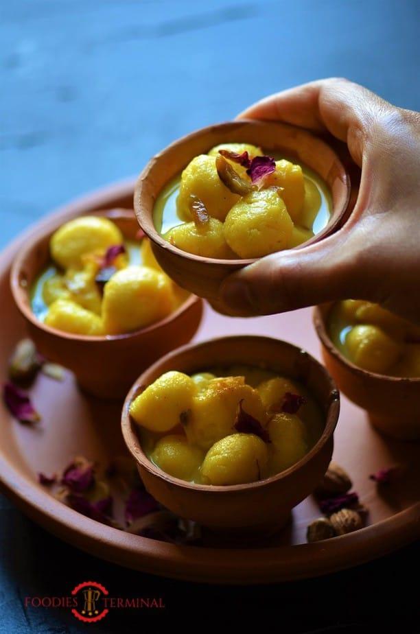 Angoori rasmalai garnished with rose petals