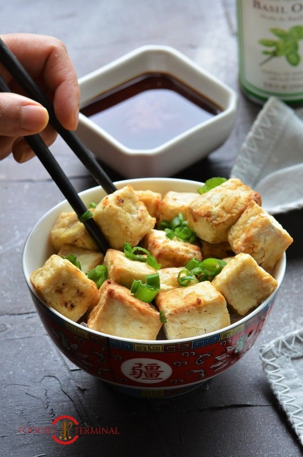 Air Fried Tofu Bites eaten with chopsticks