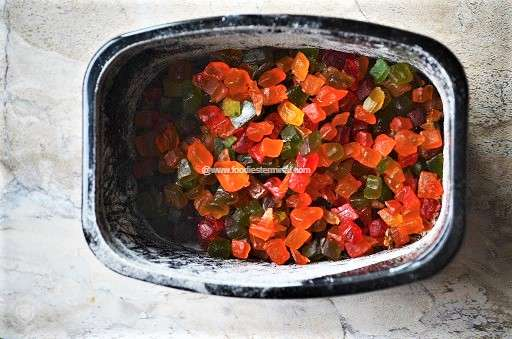 Candied papaya pieces in a black tray