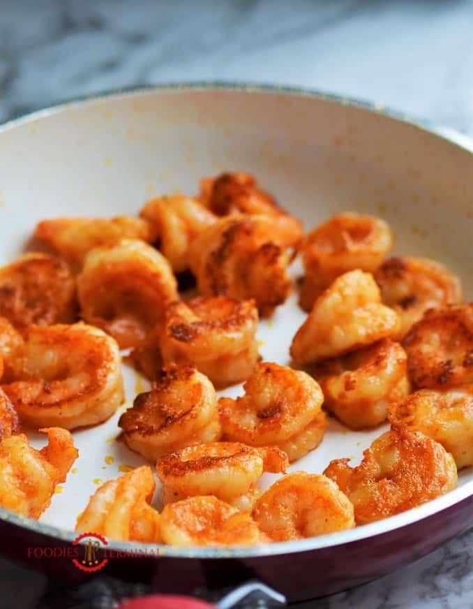 Cajun Shrimps on a white skillet
