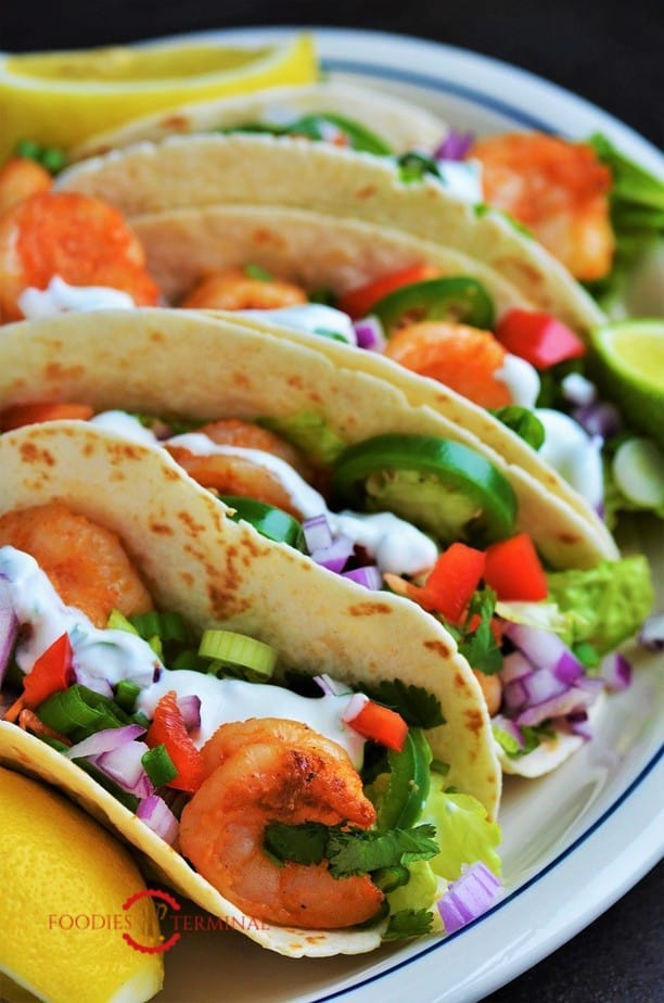 Cajun Shrimp Tacos served on a white plate