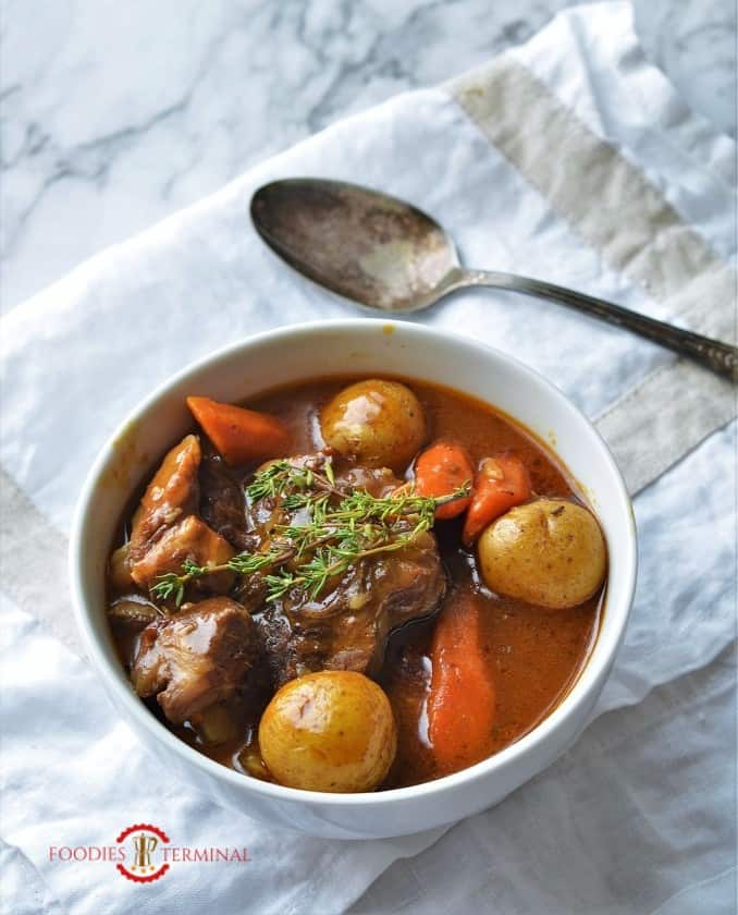 Lamb stew cooked with root vegetable in instant pot