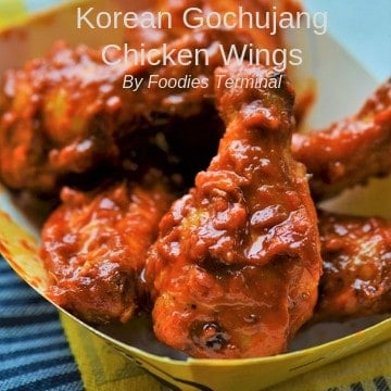 Korean Gochujang chicken wings served in a paper plate