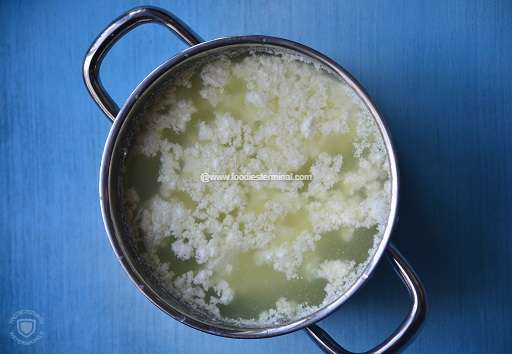 Curdled milk in a steel pot