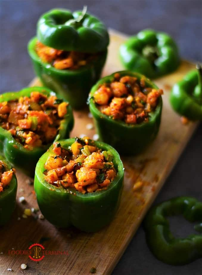 Stuffed bell peppers with shrimp on a wood board