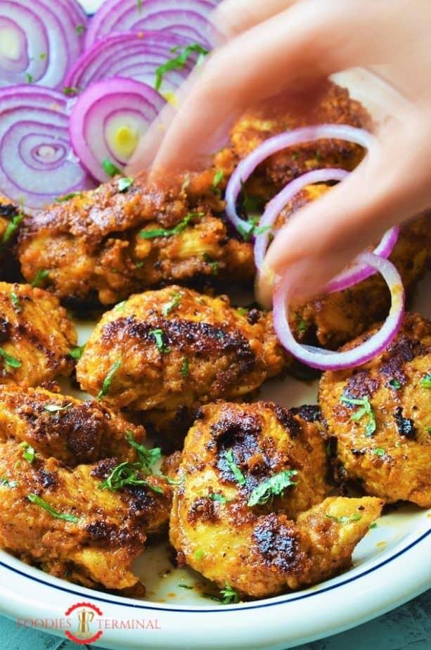 Achari Murgh tikka served with red onion