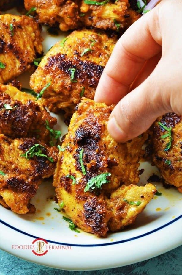 Achari chicken kabab picked with hand