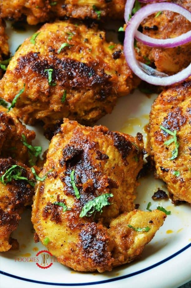 Achari Chicken Tikka garnished with chopped cilantro