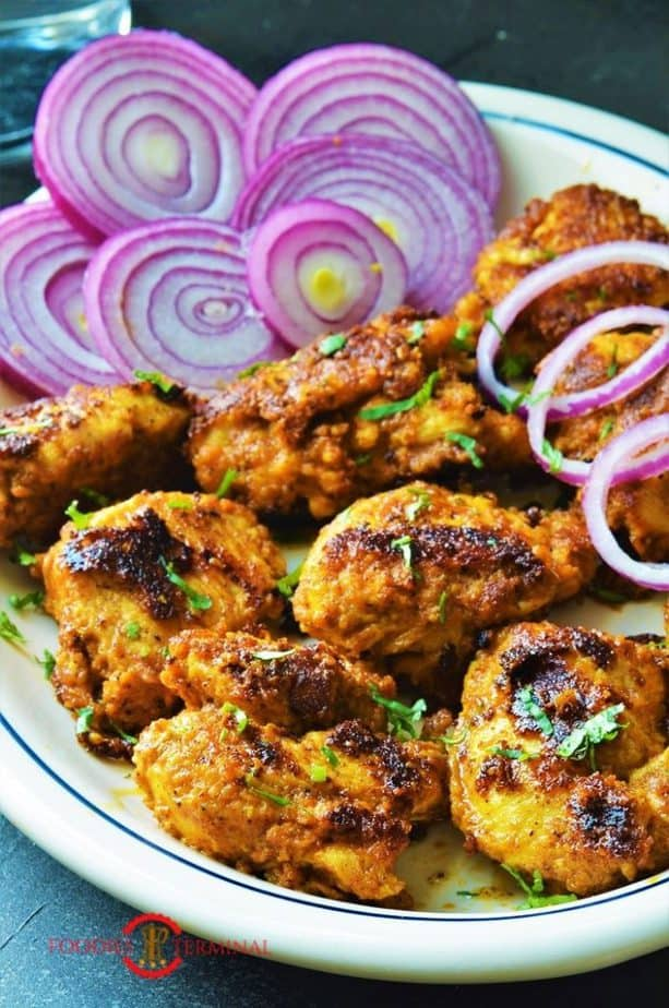 Achari Chicken Tikka served in with lots of onion