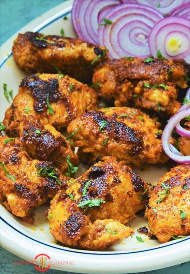 Achari Chicken Tikka recipe served with red onion rings