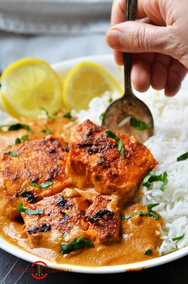 Fish tikka masala recipe served in a white plate