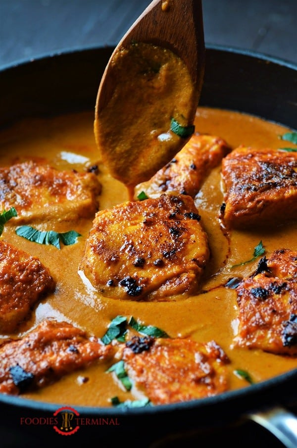 Fish Tikka masala cooked with salmon in a skillet