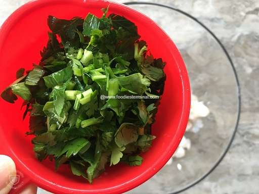 Chopped parsley in a red cup