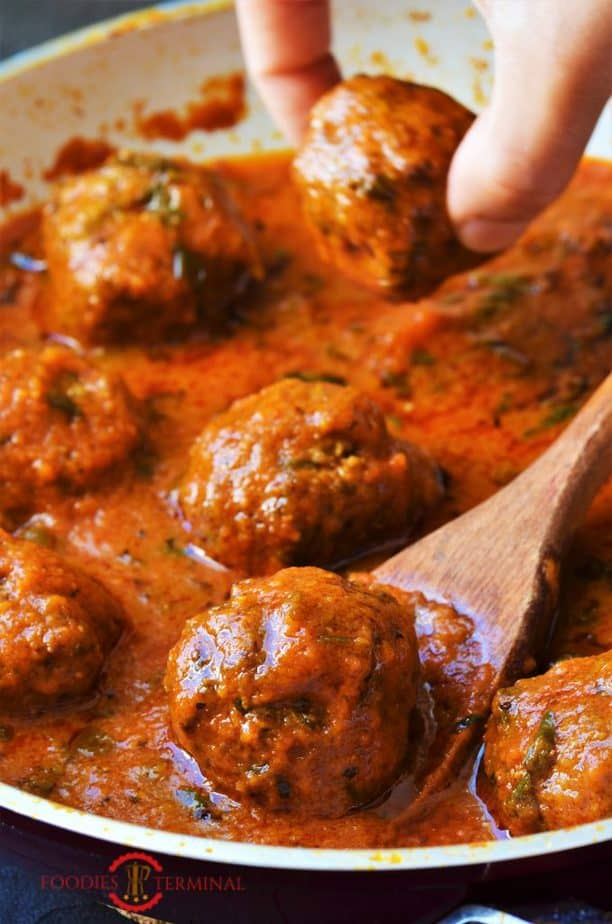 Mutton Kofta Curry with a wooden spoon