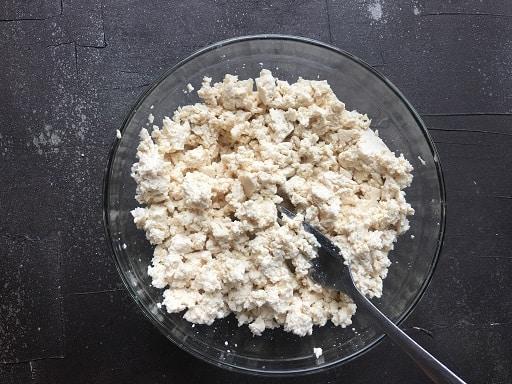 Scrambled tofu in a glass bowl