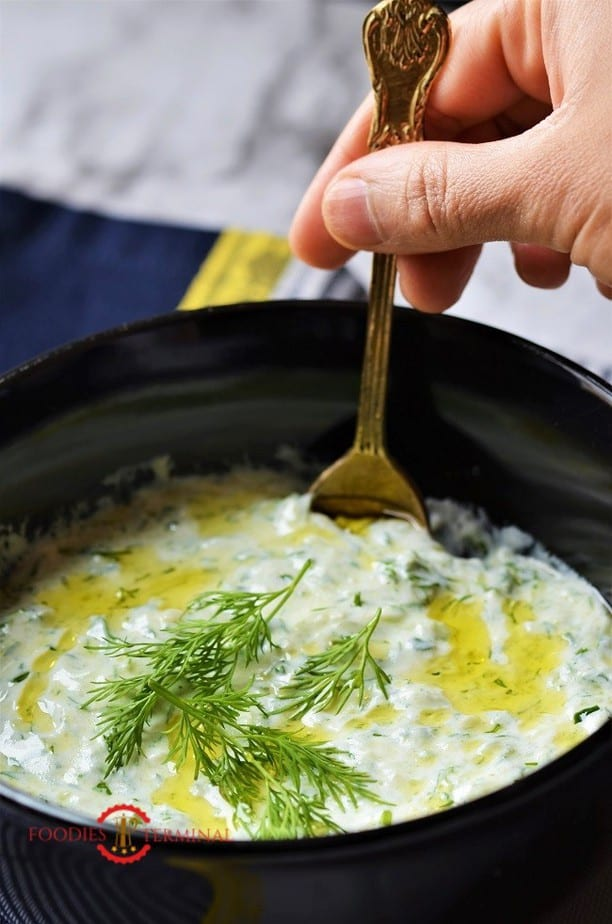 Authentic Greek Tzatziki Sauce in a black bowl