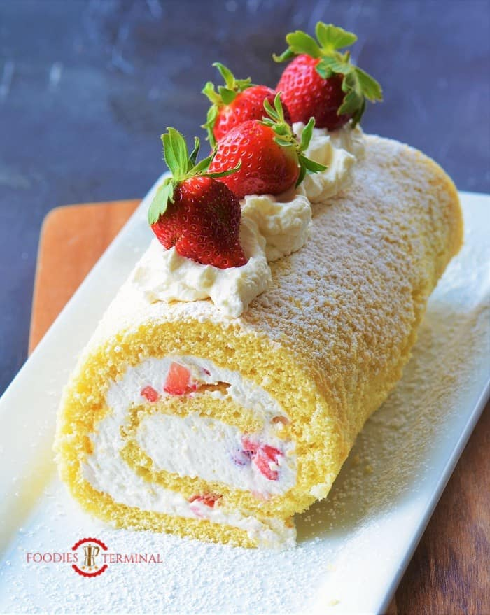 Cake roll filled with whipped cream & strawberries