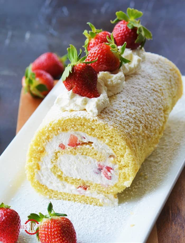 Cake Roll filled with whipped cream & topped with Strawberries