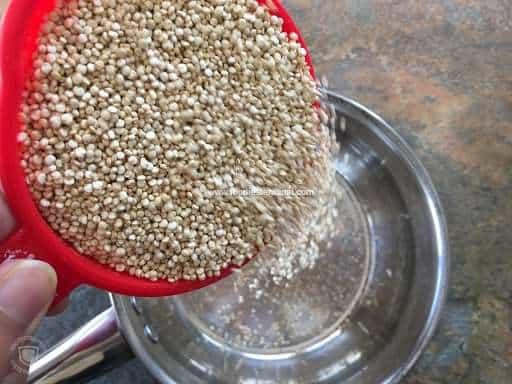Pouring raw quinoa in a saucepan