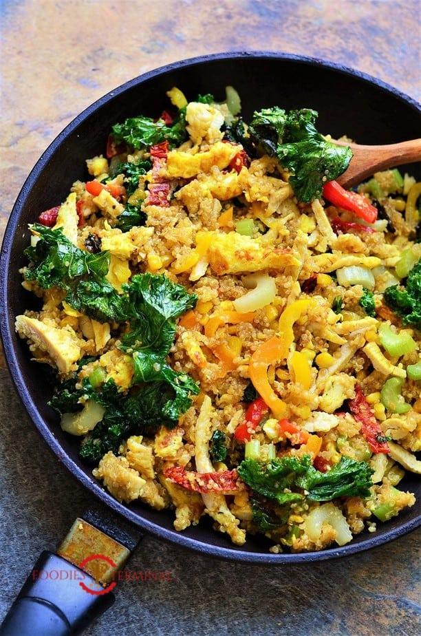 Warm quinoa salad in a black skillet
