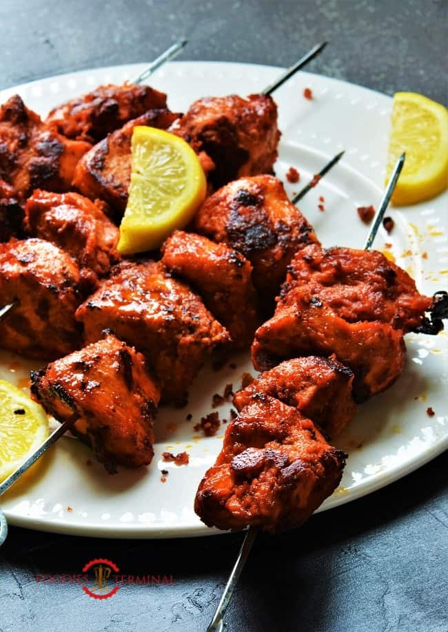 Chicken boti kaba skewered & kept on a white plate