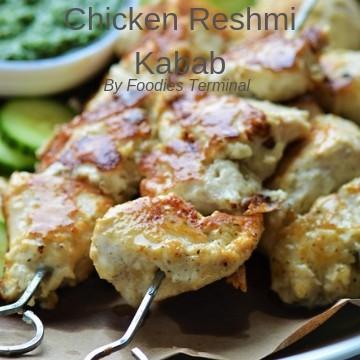 chicken reshmi kabab skewered in metal skewers