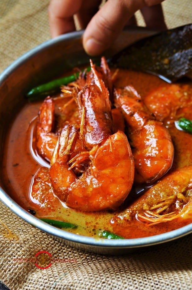Prawn Malai Curry cooked with colossal prawns & served in a small metal plate kept on a jute placemat