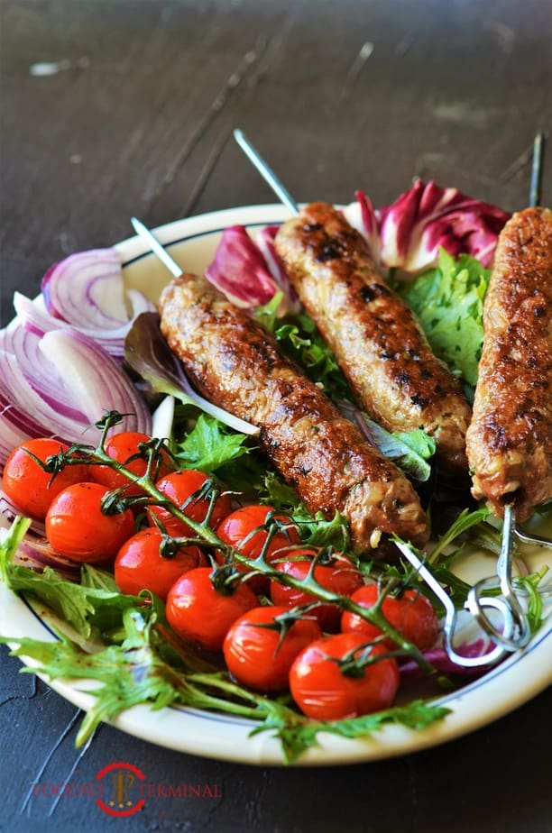 Mutton seekh kabab served on a white plate