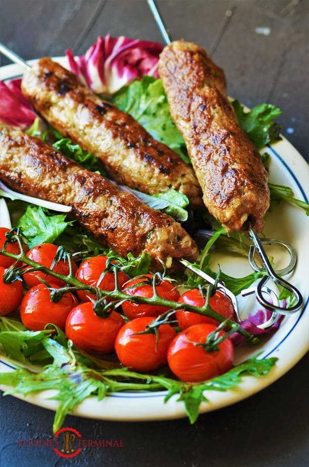 Mutton Seekh kabab served with cherry tomatoes