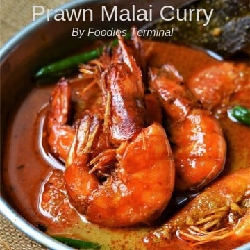 Prawn Malai Curry served in an aluminum plate in a red curry sauce
